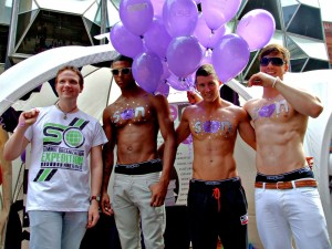 Photo of Robert alongside three models representing Seen magazine at Liverpool Pride 2010