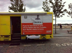 """Liverpool Primary Care trust van with the slogan: """"If you've had blood in your poo or looser poo for 3 weeks, your doctor wants to know."""""""