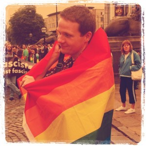 Instagram photo of Robert wrapped in the Pride flag