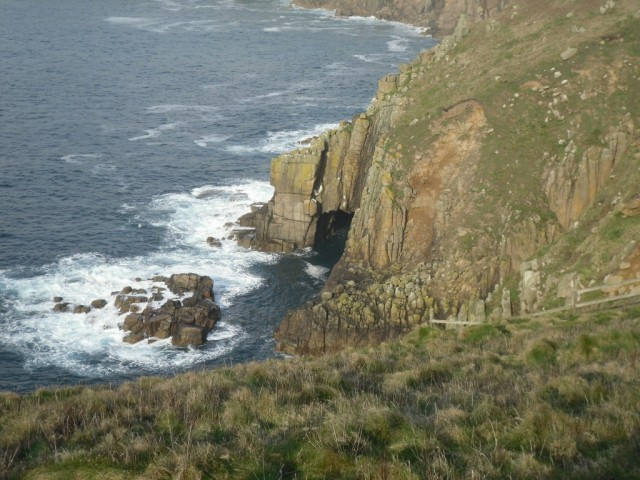 Photo of natural arch in headland at Land's End