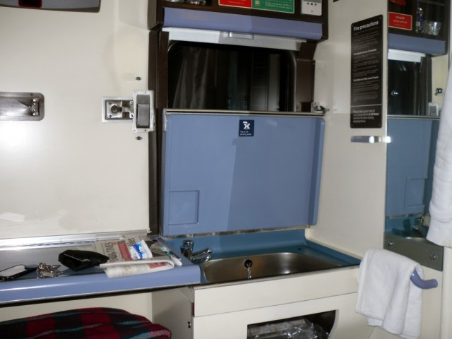Photo of sleeper compartment showing bed and sink